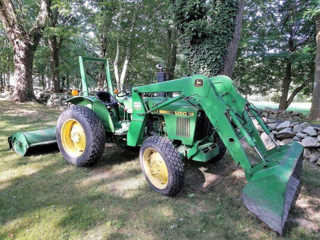 John Deere Model #1250 4WD Tractor w/bucket & flail
