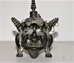 Brass cigar lighter 19th c formed as a smiling
