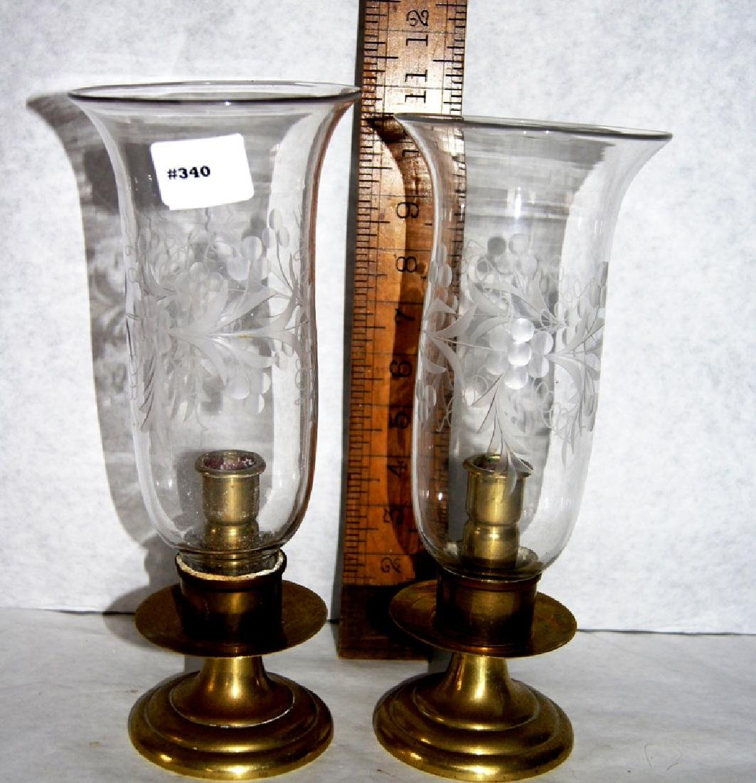Pair of spun brass candlesticks with etched glass
