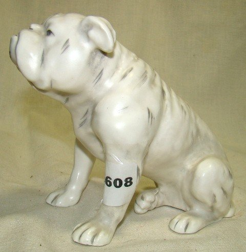 "608: Pottery white seated bulldog, number ""11578"" incis"