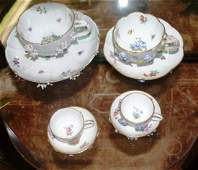4 graduated Meissen cups & saucers w/raised flowers