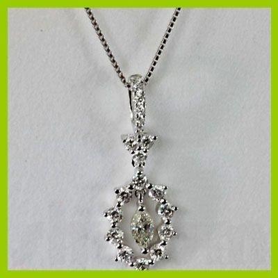 142533497: Genuine 0.550 ctw Hang  Diamond Pendant 18kt