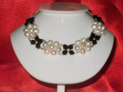 NATURAL 30.00 CTW ROSITAS WHITE PEARL AND BLACK ONEX BR