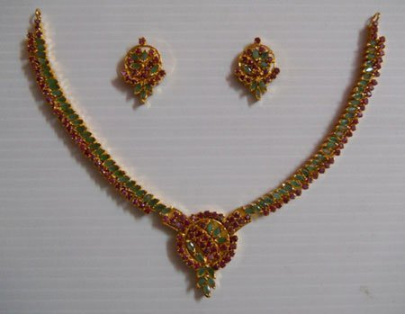 190.80 CTW GOLD PLATED EMERALD RUBY NECKLACE AND EARRIN