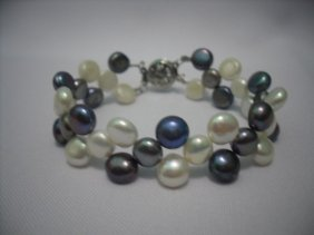 76 CTW BLACK AND WHITE SIOPAO FLAT PEARL BRACELET