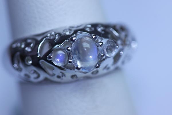 17.30 CTW MOONSTONE AND DIAMOND RING .925 STERLING SILV