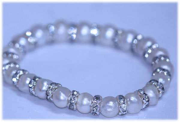 82.00 CTW WHITE PEARL AND CZ BRACELET