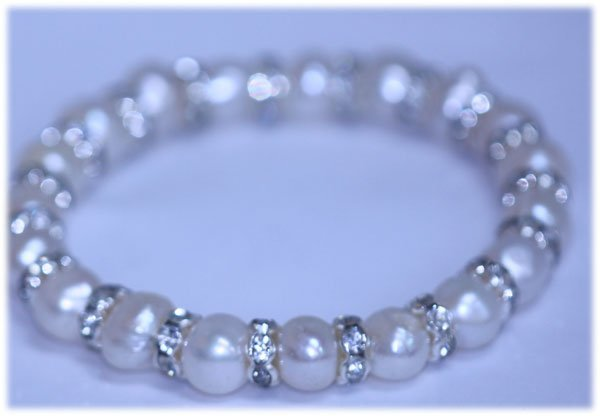 82.50 CTW WHITE PEARL AND CZ BRACELET