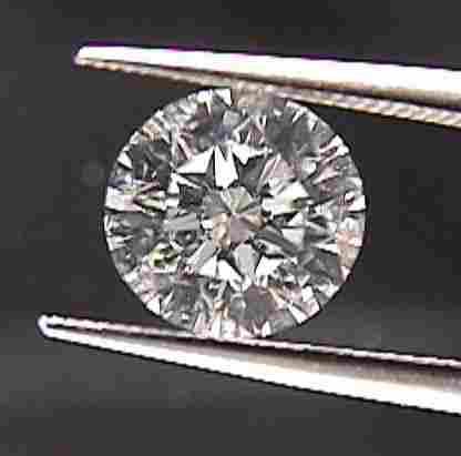 GIA CERT. 0.72 CTW ROUND DIAMOND D/VS1