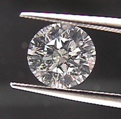 GIA CERT. 0.72 CTW ROUND DIAMOND D/VS1