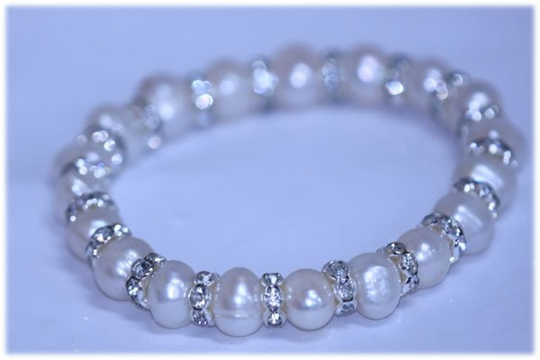 92.55 CTW WHITE PEARL AND CZ BRACELET