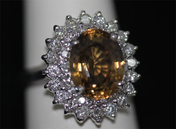 14K GOLD OVAL ZIRCON AND DIAMOND RING