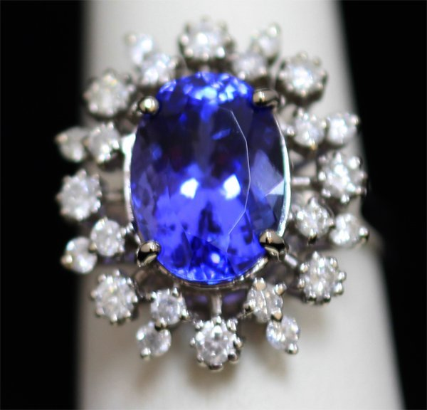 14K GOLD OVAL TANZANITE AND DIAMOND RING