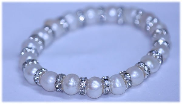 83.55 CTW WHITE PEARL AND CZ BRACELET