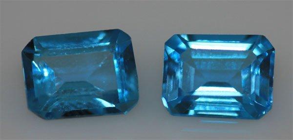 5.89 CTW BLUE TOPAZ EMERALD CUT 7X9MM (2)