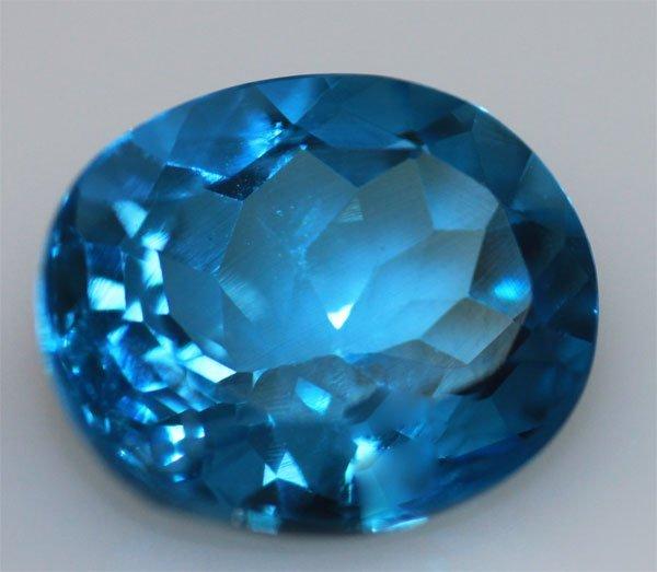 10.04 CTW BLUE TOPAZ OVAL 12X14MM