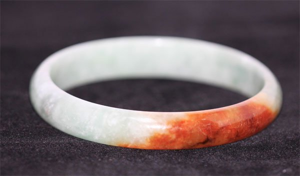 CHINESE BROWN AND WHITE JADE BANGLE
