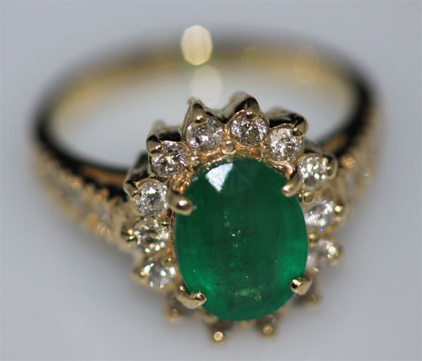 14K GOLD OVAL EMERALD AND DIAMOND RING