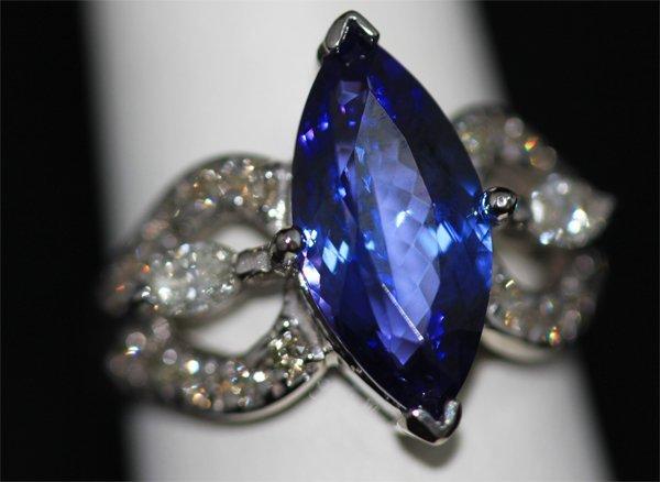 14K GOLD MARQUISE TANZANITE AND DIAMOND RING