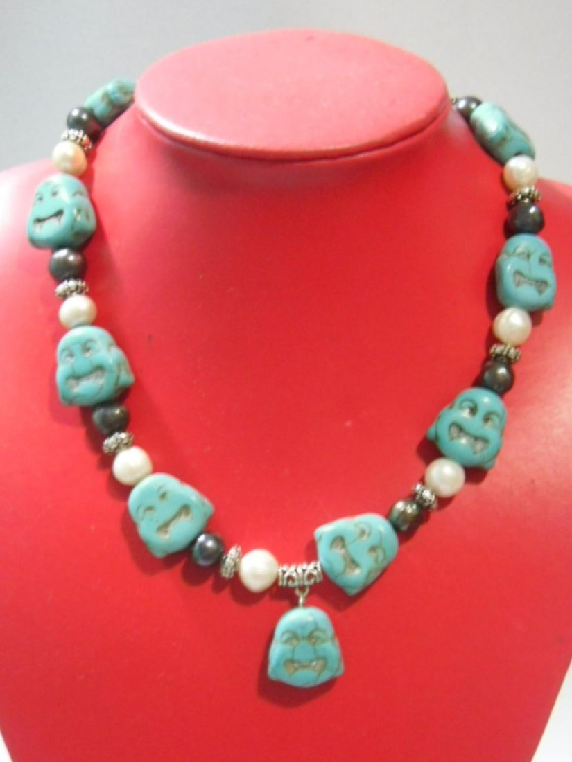 505CTW NATURAL BLUE TURQUOISE BUDDHA AND PHILIPPINE PEA