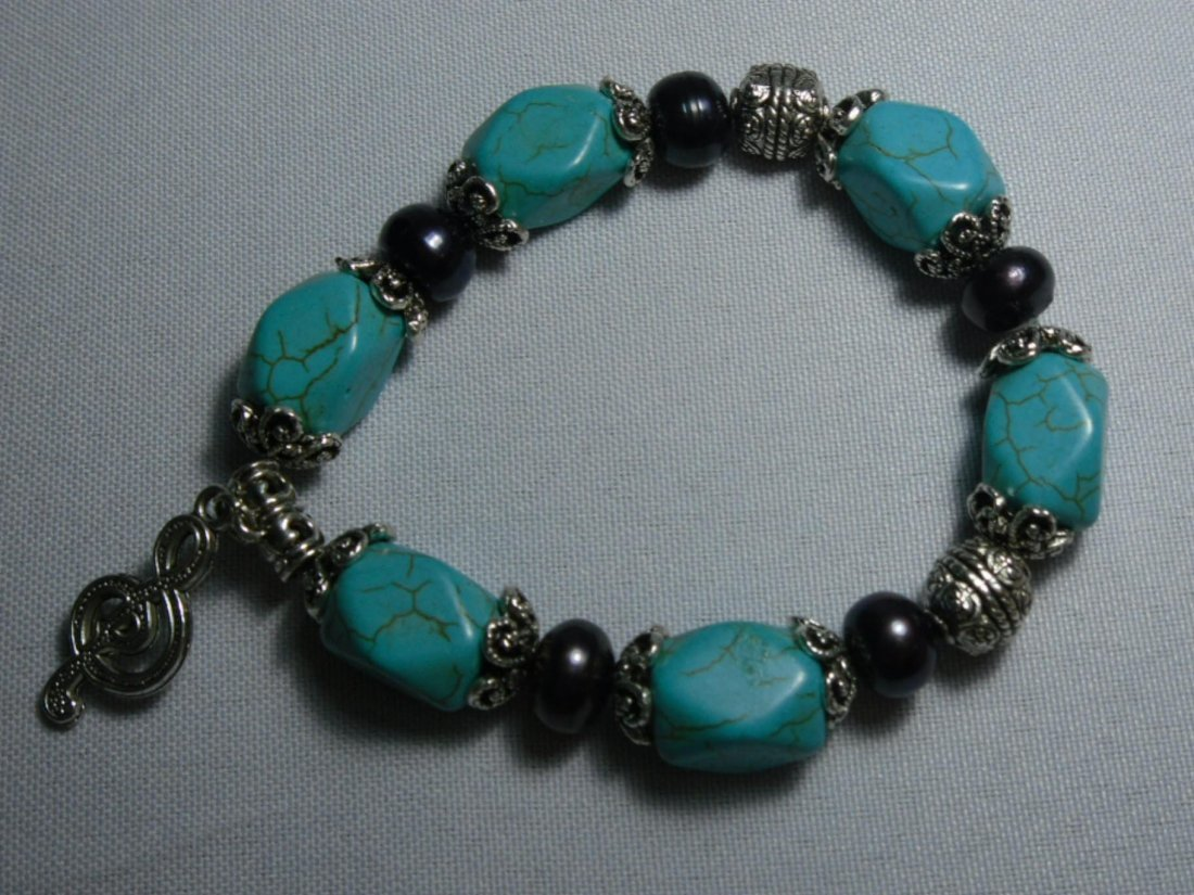 251CTW NATURAL BLUE TURQUOISE AND PHILIPPINE BLACK PEAR