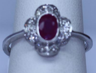 8.75 CTW RUBY AND DIAMOND RING .925 STERLING SILVER