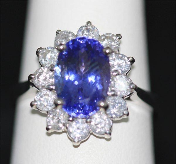 DIAM 1.12 CTW; 14K GOLD OVAL TANZANITE AND DIAMOND RING