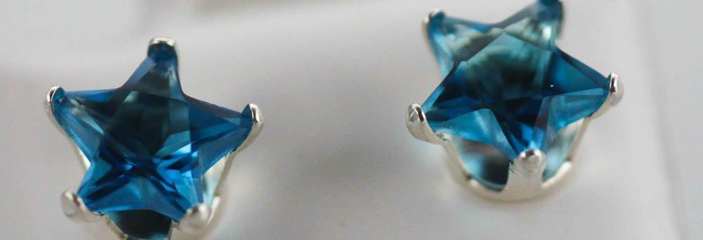 BLUE TOPAZ CZ STAR STUD EARRINGS .925 STERLING SILVER
