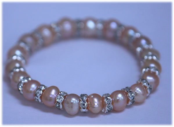 83.55 CTW PEACH PEARL AND CZ BRACELET