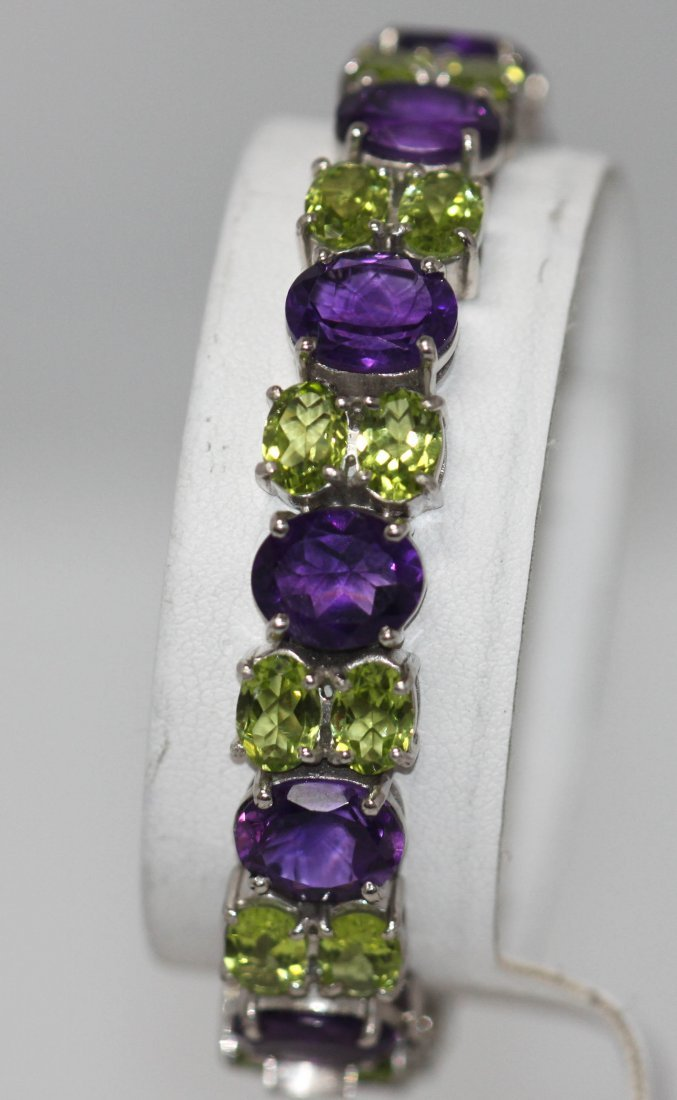44.71 CTW AMETHYST AND PERIDOT .925 STERLING SILVER RIN