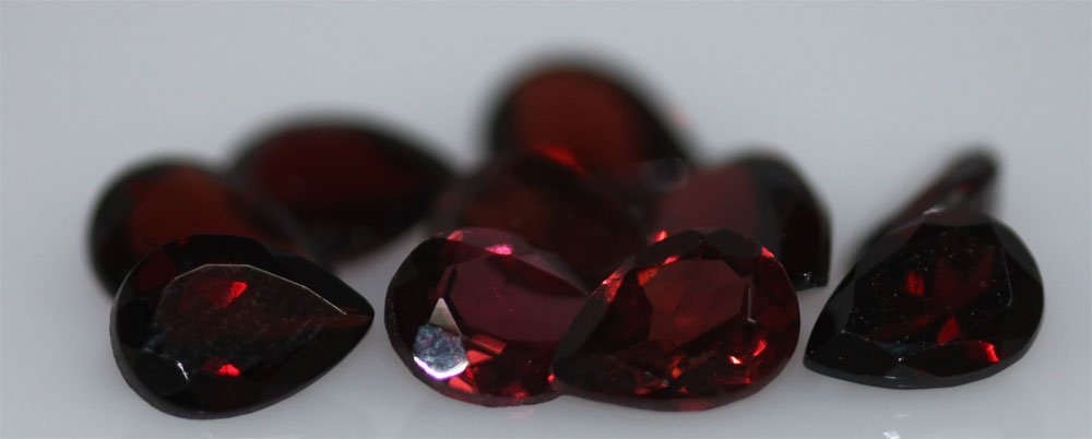 8.64 CTW GARNET PEARSHAPED 5X7MM (10)