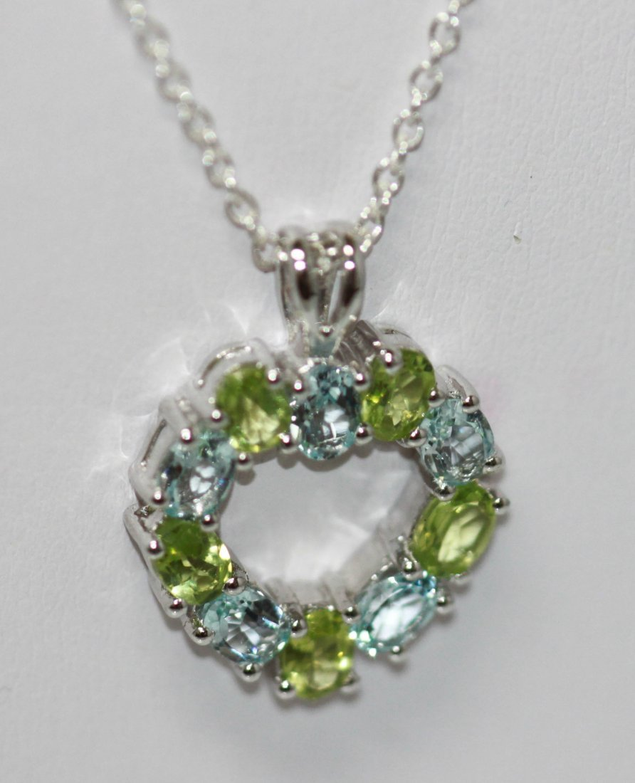 1.25 CTW peridot and blue topaz Pendant with chain .925 - 2