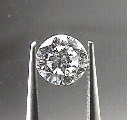GIA CERT. 0.6 CTW ROUND DIAMOND D/VS1