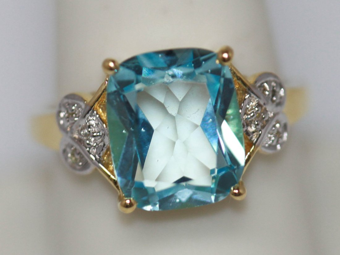 12.09 CTW 14 K Gold Plated silver Blue Topaz Ring