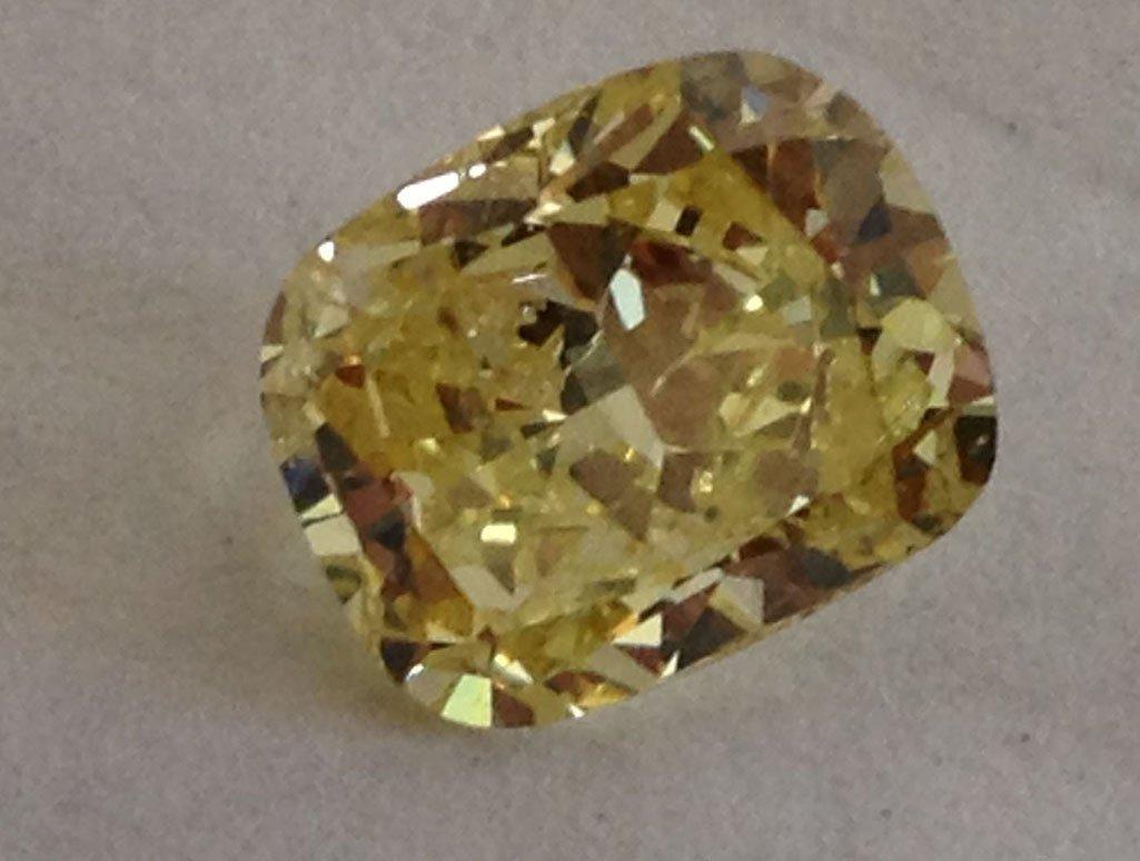 GIA CERT 1.65 CTW RADIANT DIAMOND YELLOW/FANCY LIGHT