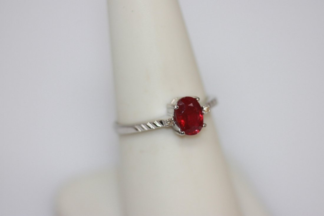 .75 CTW RUBY AND DIAMOND RING .925 STERLING SILVER
