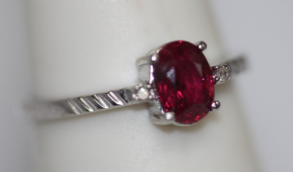 1.07 CTW RUBY AND DIAMOND .925 STERLING SILVER RING