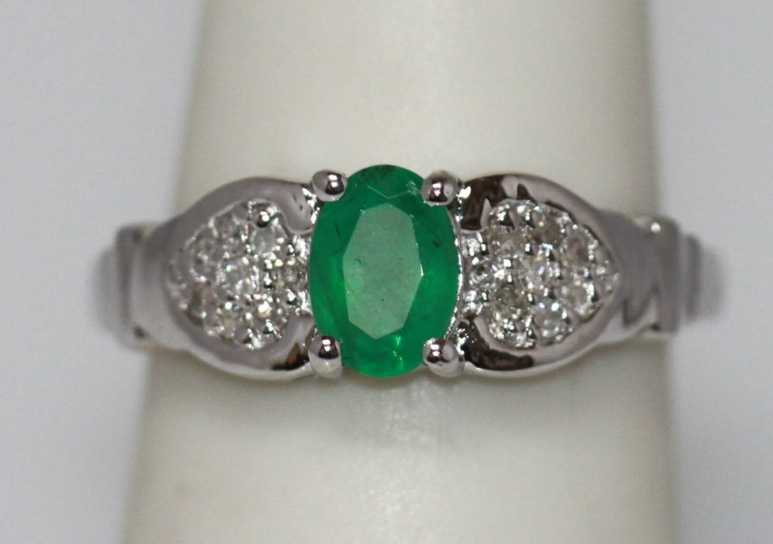 0.82 CTW EMERALD AND DIAMOND RING .925 STERLING SILVER