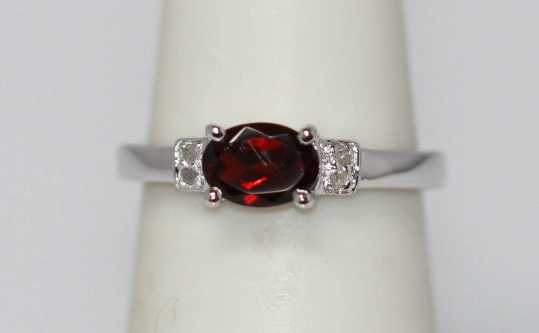 0.50 CTW Garnet and diamond Ring .925 Sterling Silver