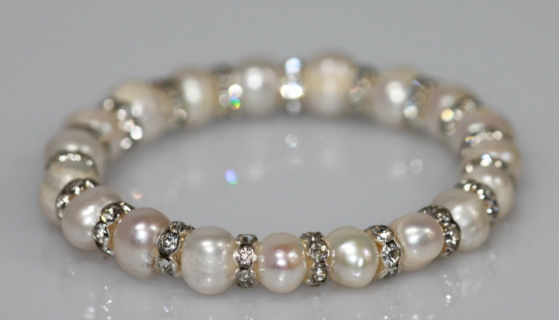 95.90 CTW WHITE PEARL AND CZ BRACELET