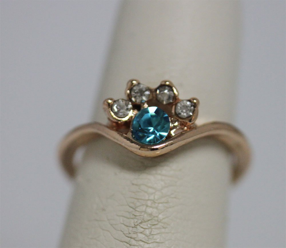 LIGHT BLUE AND CLEAR CZ GOLD PLATED BRASS RING