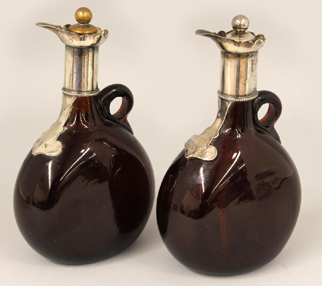 PAIR OF AMBER GLASS AND SILVERED LIQUOR BOTTLES