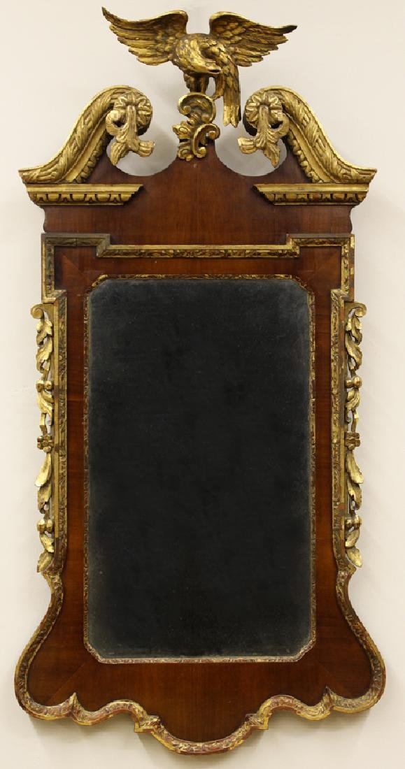 CHIPPENDALE MAHOGANY AND PARCELGILT CONSTITUTION MIRROR
