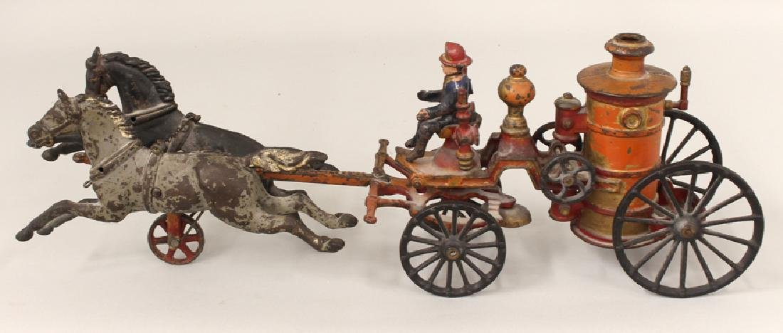 19TH C. CAST IRON FIRE PUMP WITH HORSES