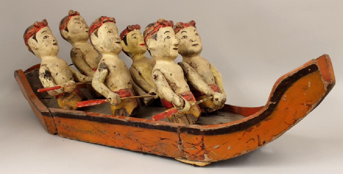 ASIAN CARVED AND PAINTED FOLK ART BOAT WITH FIGURES