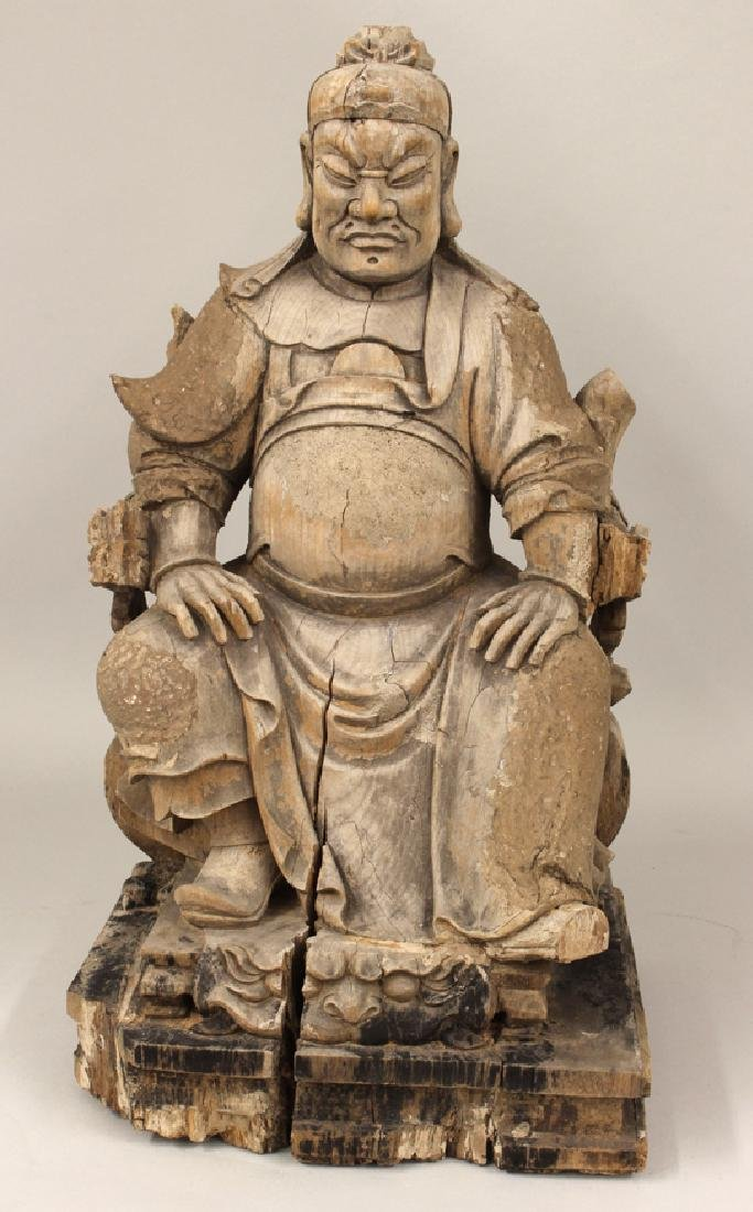 CHINESE CARVED GUARDIAN FIGURE