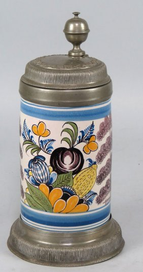GERMAN DECORATED CERAMIC AND PEWTER STEIN