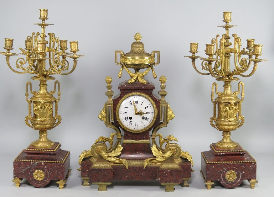 168: FRENCH ROUGE MARBLE AND FIREGILT BRONZE CLOCK SET