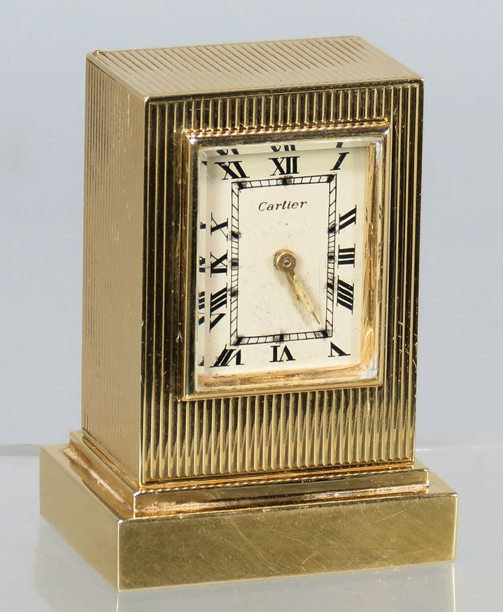 606: SMALL 14K GOLD CLOCK, CARTIER