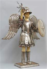 SPANISH COLONIAL POLYCHROMED FIGURE WITH SILVER MOUNTS